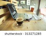 blurred cup of coffee with... | Shutterstock . vector #313271285