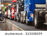 row of brand new  shiny  trucks ... | Shutterstock . vector #313338359