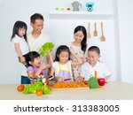 asian family in the kitchen | Shutterstock . vector #313383005