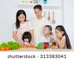 asian family in the kitchen | Shutterstock . vector #313383041