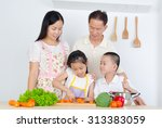 asian family in the kitchen | Shutterstock . vector #313383059