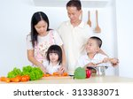 asian family in the kitchen | Shutterstock . vector #313383071
