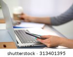 young businesswoman working on... | Shutterstock . vector #313401395