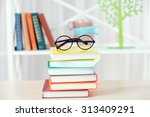 Stack Of Books With Glasses On...