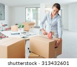 young business woman taping up... | Shutterstock . vector #313432601