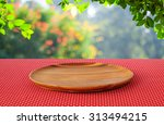 Empty Round Wooden Tray On Red...