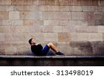 young sportsman doing abdominal ... | Shutterstock . vector #313498019