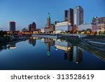 Small photo of Scioto River and Columbus Ohio skyline at John W. Galbreath Bicentennial Park at dusk