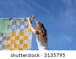longhaired young woman putting... | Shutterstock . vector #3135795