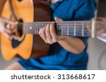 girl playing acoustic guitar... | Shutterstock . vector #313668617