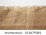 burlap fabric with frayed edge | Shutterstock . vector #313679381
