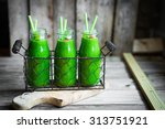 fresh green smoothie on rustic... | Shutterstock . vector #313751921