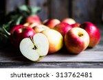 apples on rustic wooden... | Shutterstock . vector #313762481