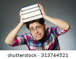 funny student with many books | Shutterstock . vector #313764521
