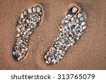 Bare Feet Made Of Pebble On Th...