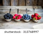 Mix Of Fresh Berries On Rustic...