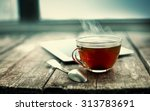 Stock photo hot tea cup on a frosty winter day window background 313783691