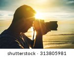 learning photography at sunset. ... | Shutterstock . vector #313805981