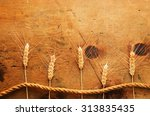 old wood table with spikelets... | Shutterstock . vector #313835435