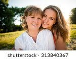 portrait of mother and her... | Shutterstock . vector #313840367