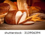 fresh assortment of baked bread | Shutterstock . vector #313906394