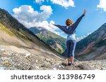 hiker girl standing on top of... | Shutterstock . vector #313986749