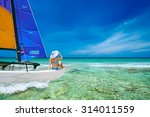 young woman traveling by boat... | Shutterstock . vector #314011559