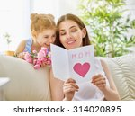 mother and daughter with flowers | Shutterstock . vector #314020895