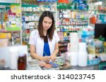 young female pharmacist prepare ... | Shutterstock . vector #314023745