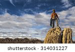 climber coils ropes on the... | Shutterstock . vector #314031227