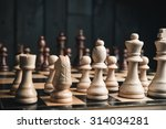 chess pieces on black wood...