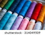 colored sewing threads. focus... | Shutterstock . vector #314049509