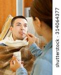 girl giving pills to diseased...   Shutterstock . vector #314064377
