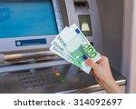 woman hand holding money at an... | Shutterstock . vector #314092697