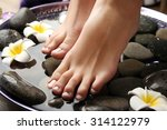 female feet at spa pedicure... | Shutterstock . vector #314122979