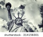 The Statue Of Liberty With A...