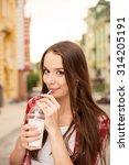 beautiful girl drinking a... | Shutterstock . vector #314205191