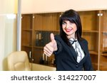 pretty smiling woman in office... | Shutterstock . vector #314227007