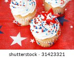 Cupcakes to celebrate an American holiday.  Used stars of red, white and blue with a red background with star shapes on it. - stock photo
