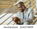 modern black businessman using... | Shutterstock . vector #314273009