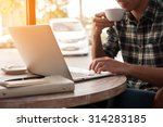 businessman using laptop with... | Shutterstock . vector #314283185