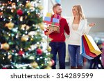 affectionate couple carrying... | Shutterstock . vector #314289599