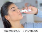 woman using a spray for blocked ... | Shutterstock . vector #314298005