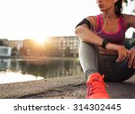 young woman runner resting... | Shutterstock . vector #314302445