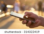 man using his mobile phone... | Shutterstock . vector #314322419