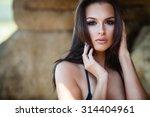 Young Woman In Black Bikini...