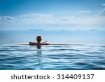 woman relaxing in infinity... | Shutterstock . vector #314409137