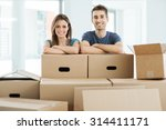 young couple posing with arms... | Shutterstock . vector #314411171