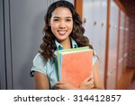 happy student against closed... | Shutterstock . vector #314412857