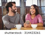 cute couple looking at a... | Shutterstock . vector #314423261